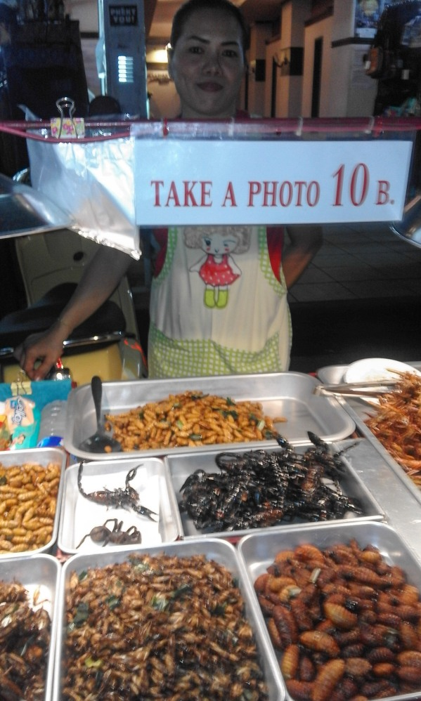 Street vendor selling fried insects on Khao San Road, Bangkok, Thailand